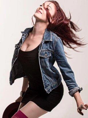 Nomi Abadi dancing modeling pose