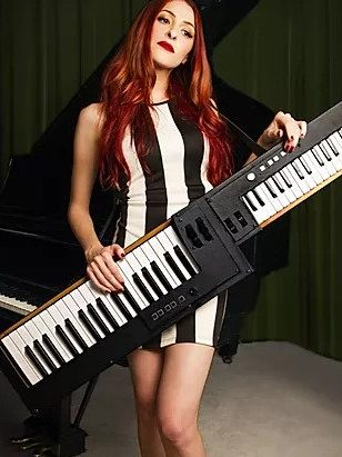 nomi abadi keytar posing using instrument